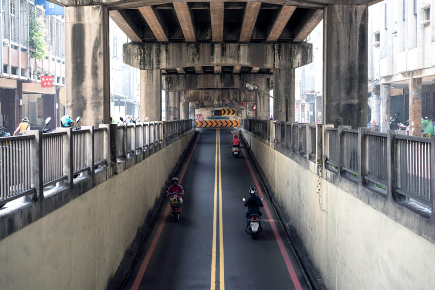 street under bridge over railway