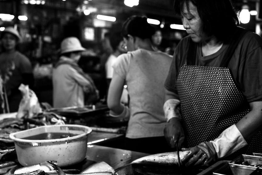 Woman working in fishmonger