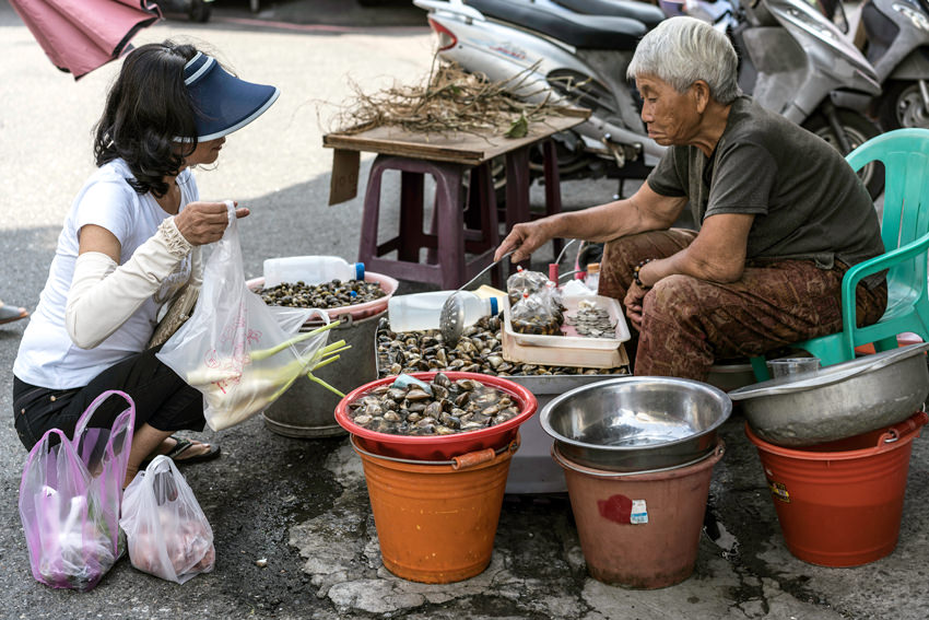 Woman selling clams