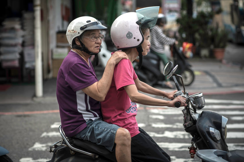 Old couple on a motorbike