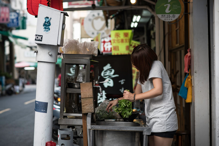 young woman grabbing greens