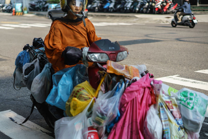 Motorbike with many plastic bag