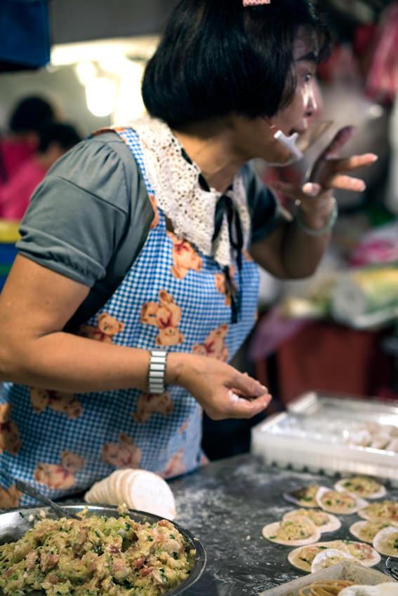 Woman working in delicatessen