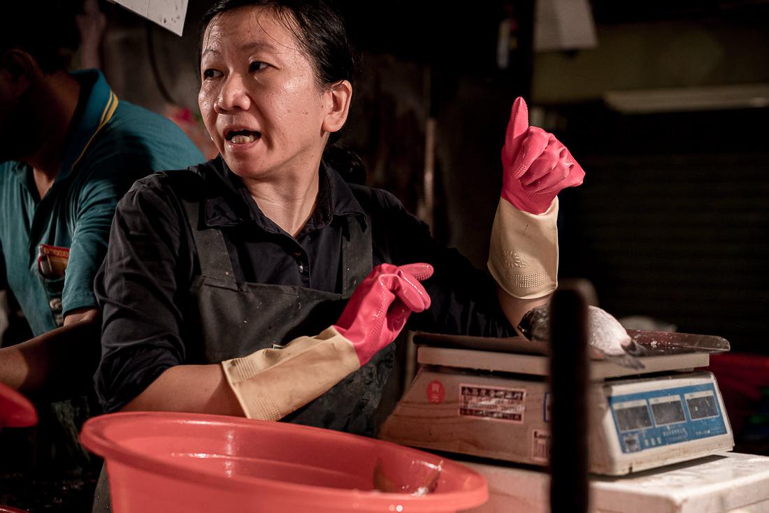 Female fishmonger and weighing machine