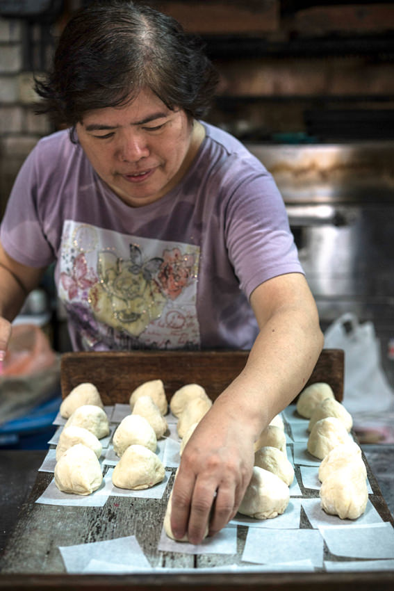 Woman setting out meat buns
