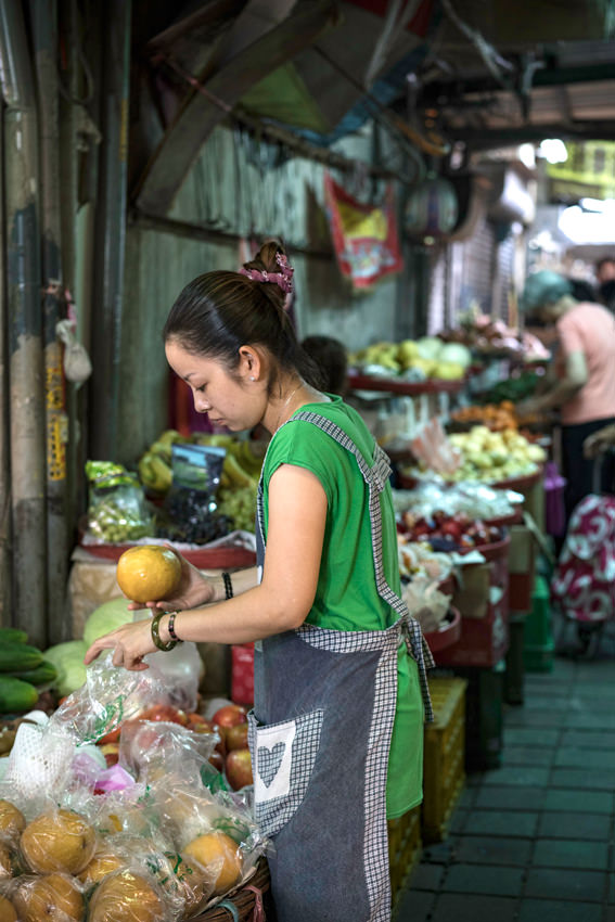 young woman grabbing pomelo