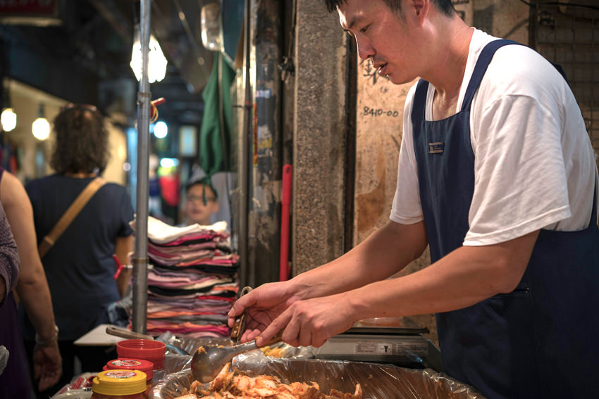 man selling Korean pickle