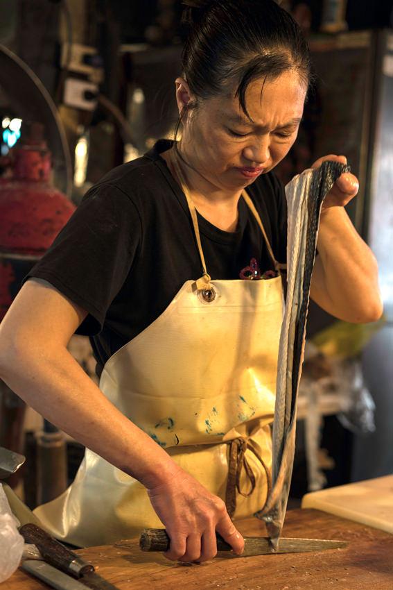 Woman cooking eel