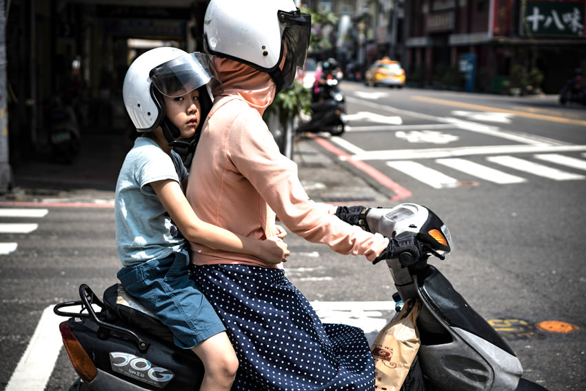 Parent and child on same motorbike