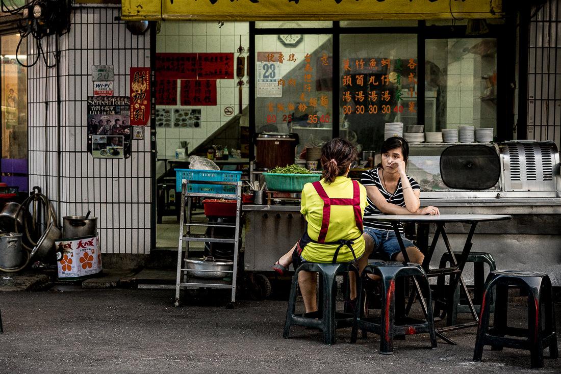 Two staffs taking seat in restaurant
