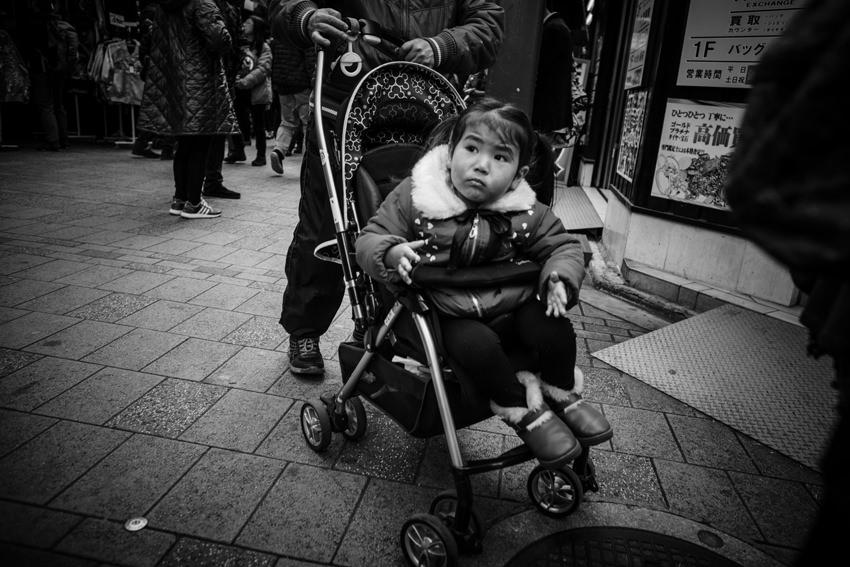 Little girl on baby buggy