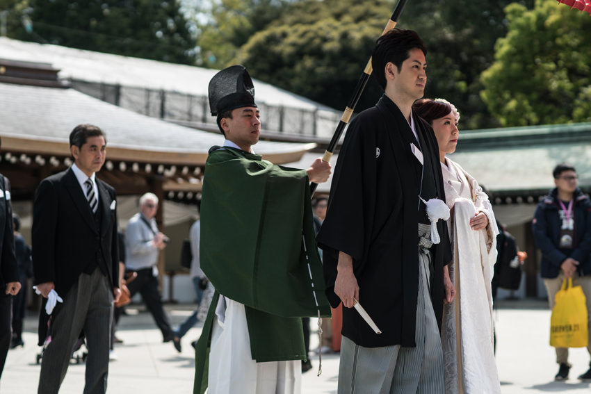 bridal couple and Shinto priest
