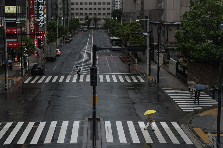 Yellow umbrella on pedestrian crossing