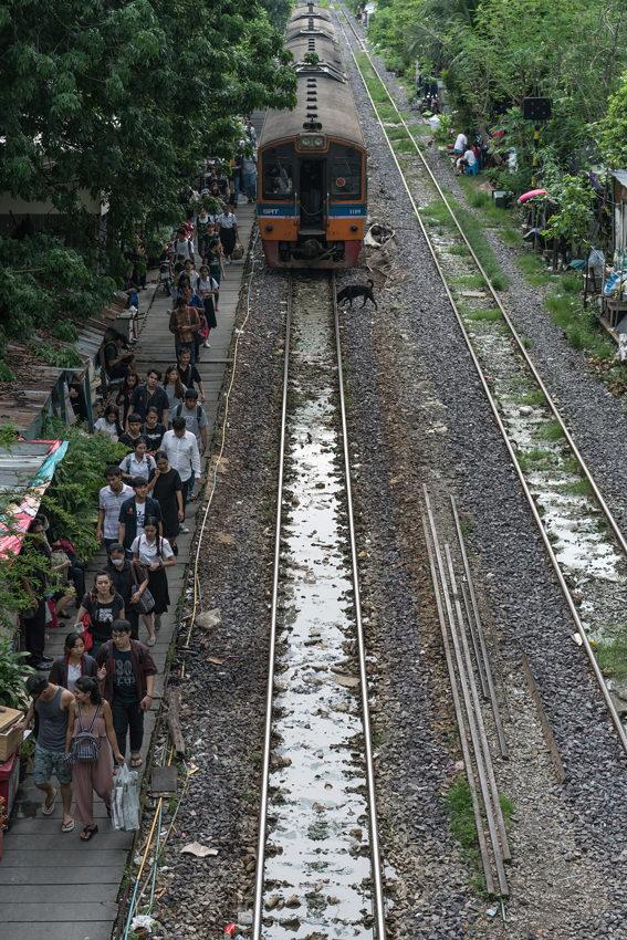Passengers on narrow platform