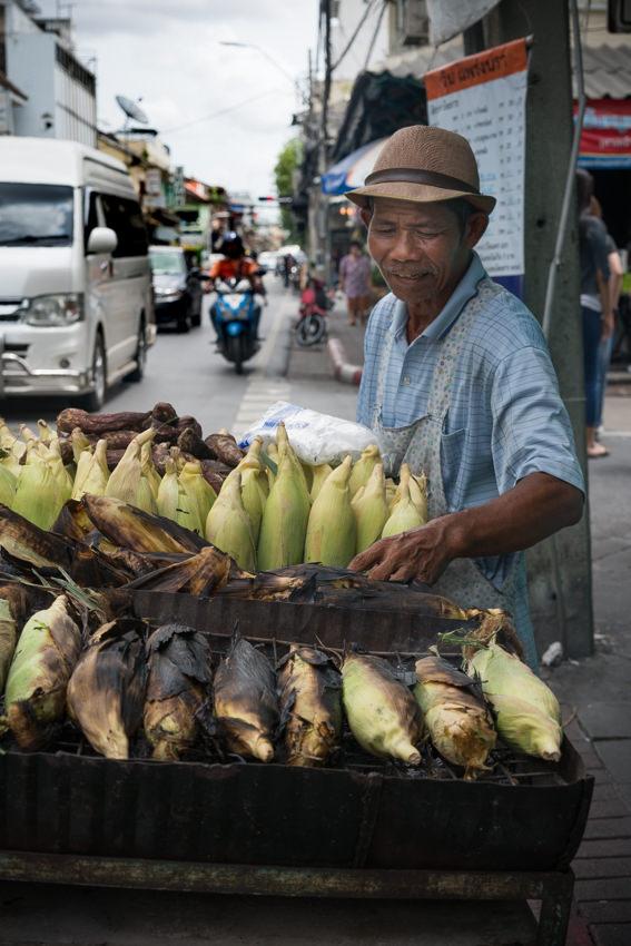 Man selling grilled bananas
