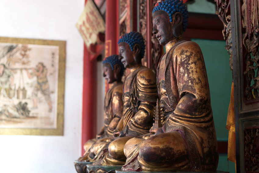 Buddha statue with blue hair