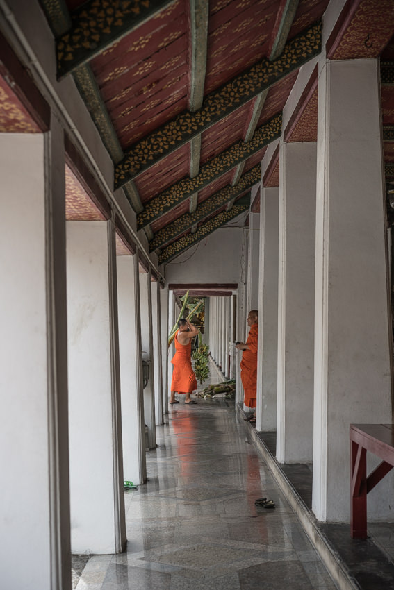 Monks at end of corridor