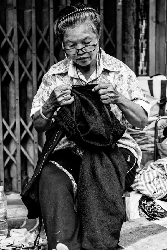Older woman sewing by hand