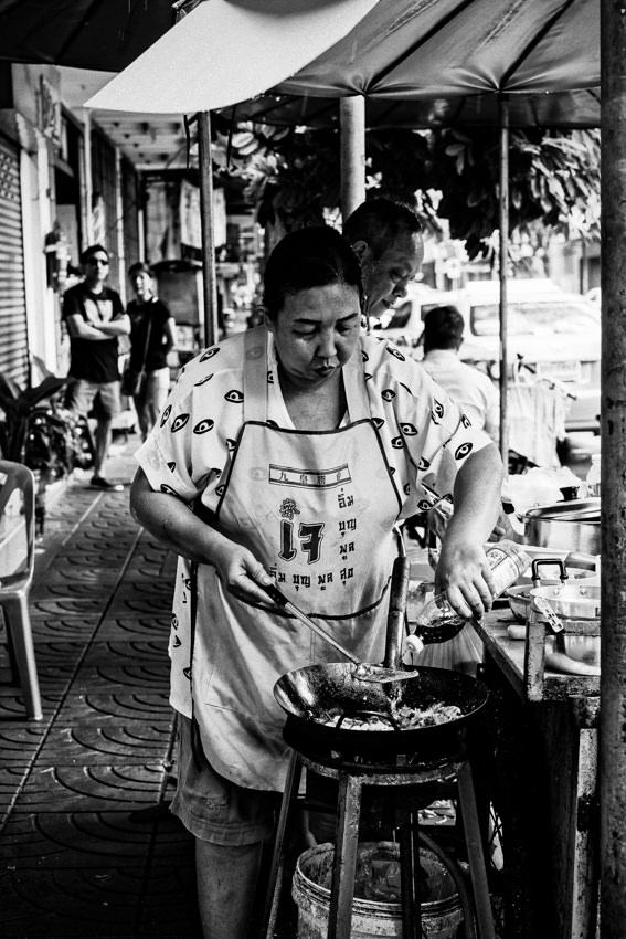 Woman adding seasoning