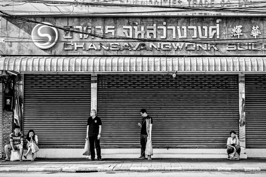 People in front of shutter
