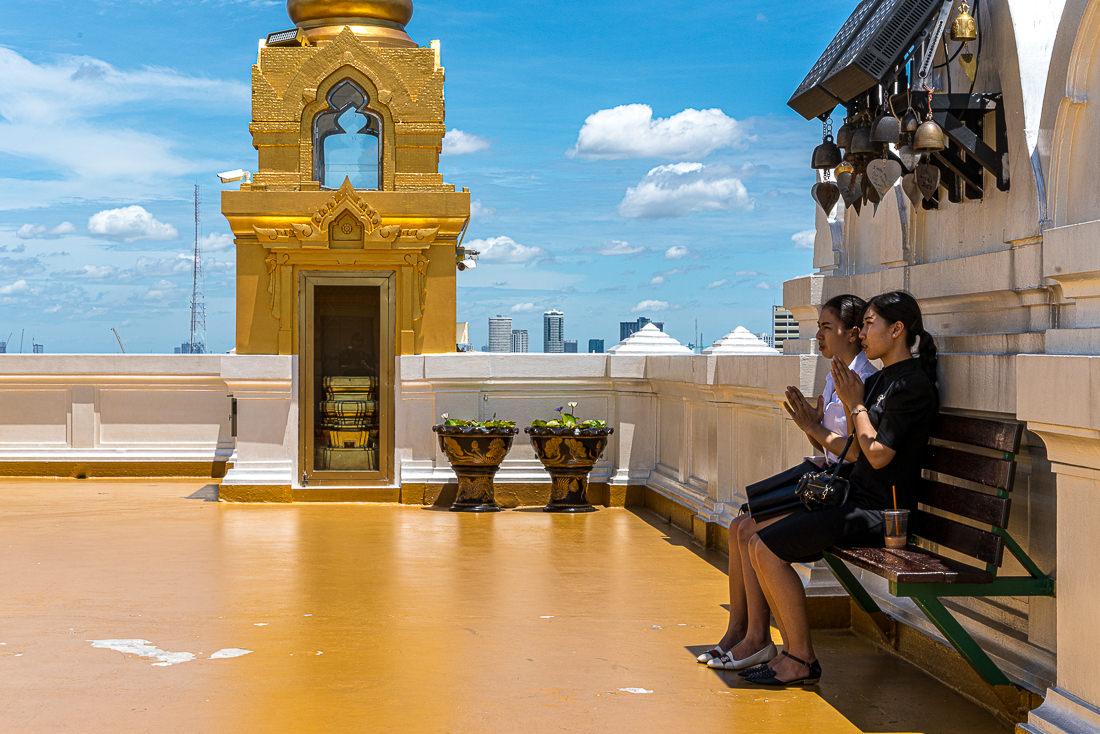 Two young women praying in Wat Saket