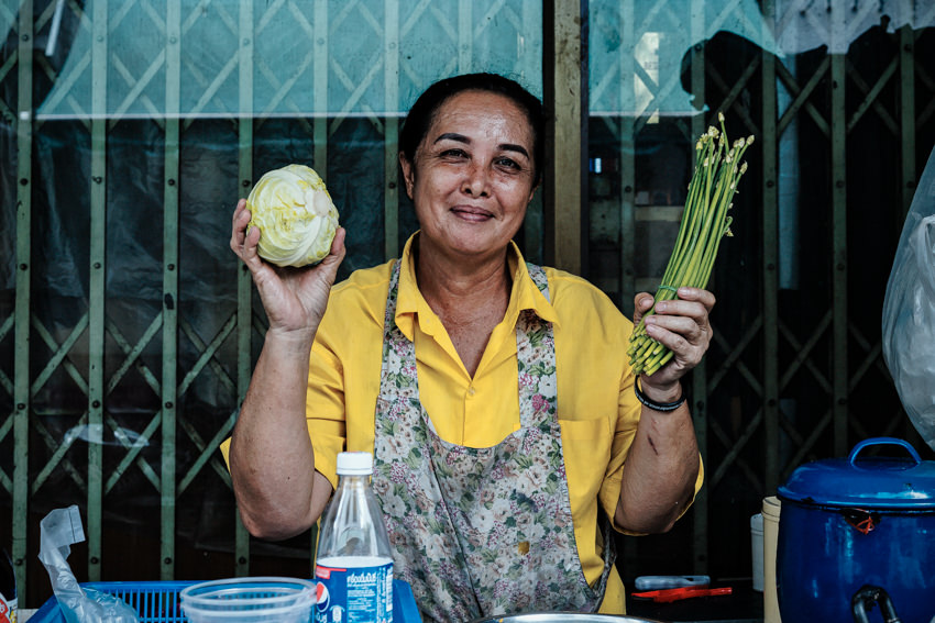 Woman having cabbage and chive