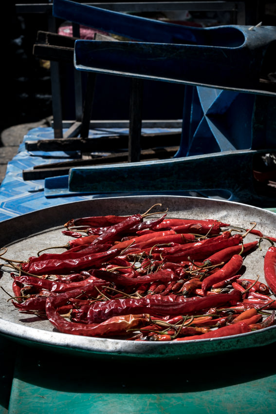 Red peppers being dried in sun