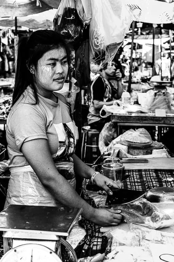 Woman working in butcher in Khlong Toei Market