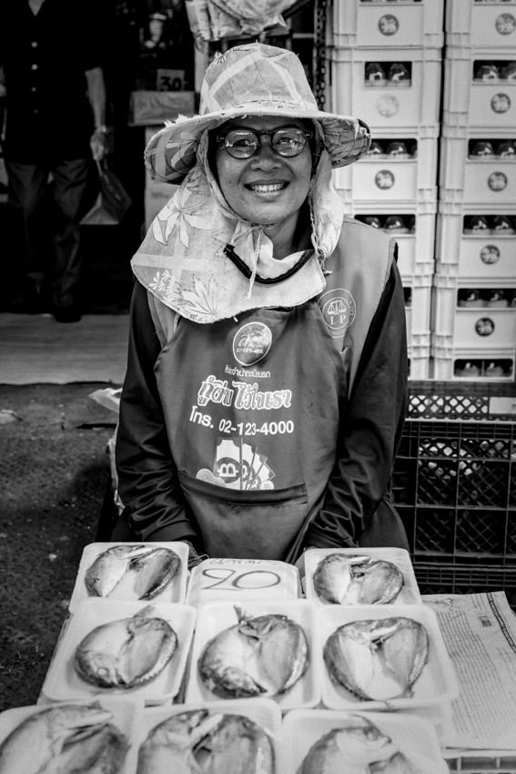 Woman selling packed fishes