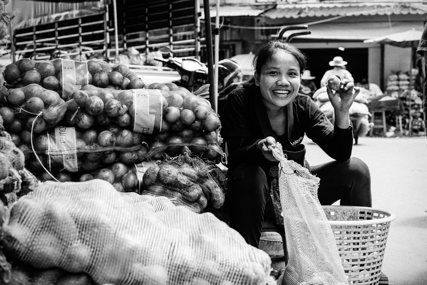 Young woman smiling with potato in hand