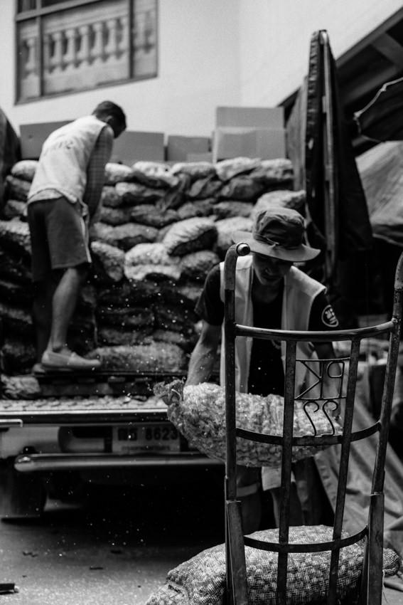 Men unloading back from truck