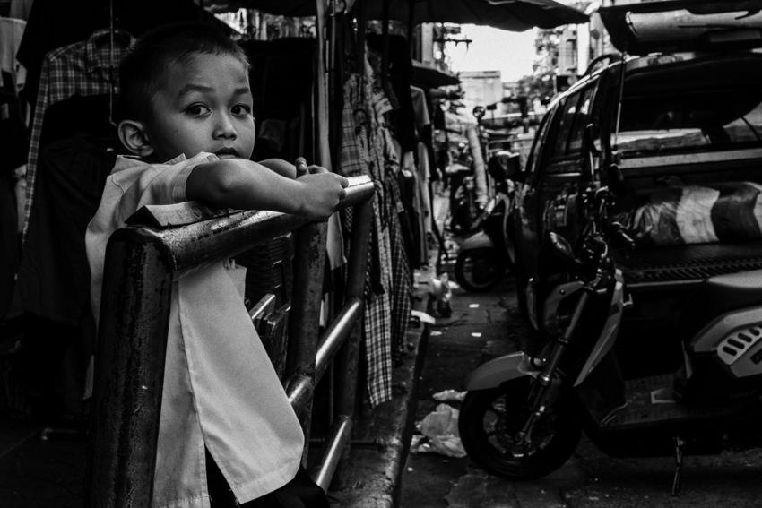 Boy leaning against handrail