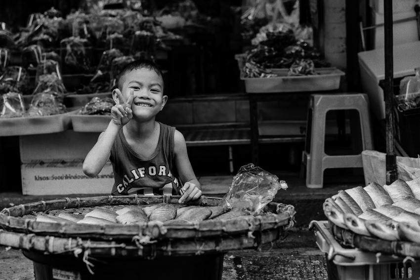 Boy selling dried fishes