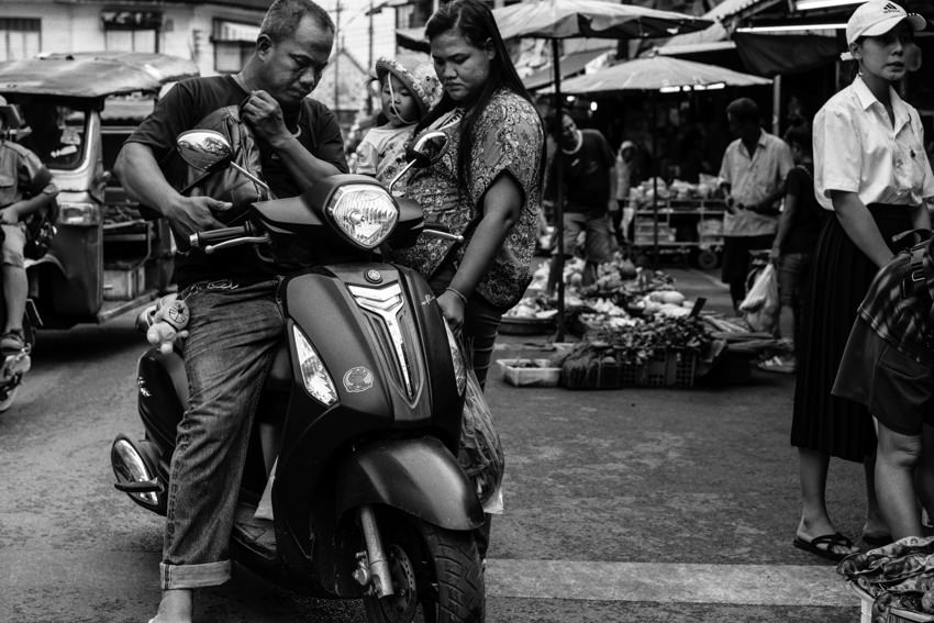 Father, mother, baby and motorbike