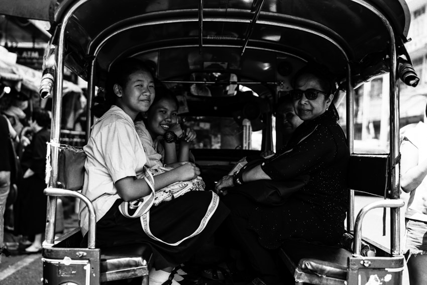 Passengers of Songthaew smiling
