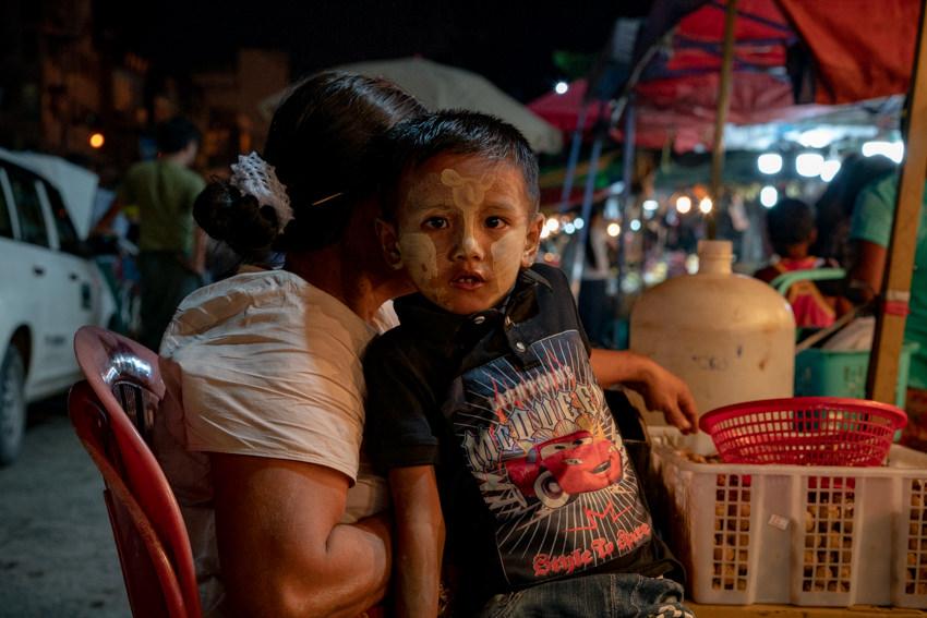 Boy painted Thanaka on face