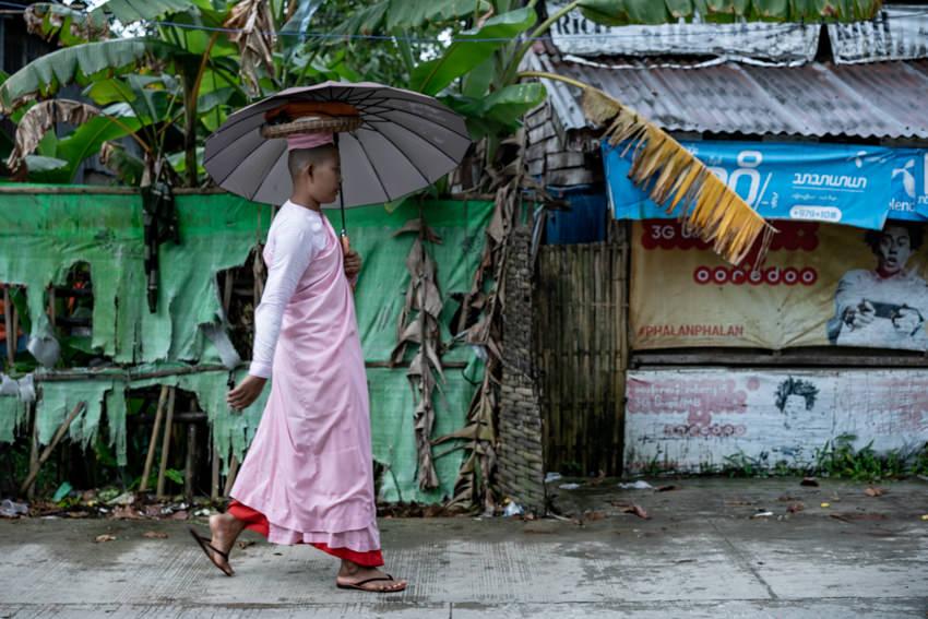 Nun walking with umbrella