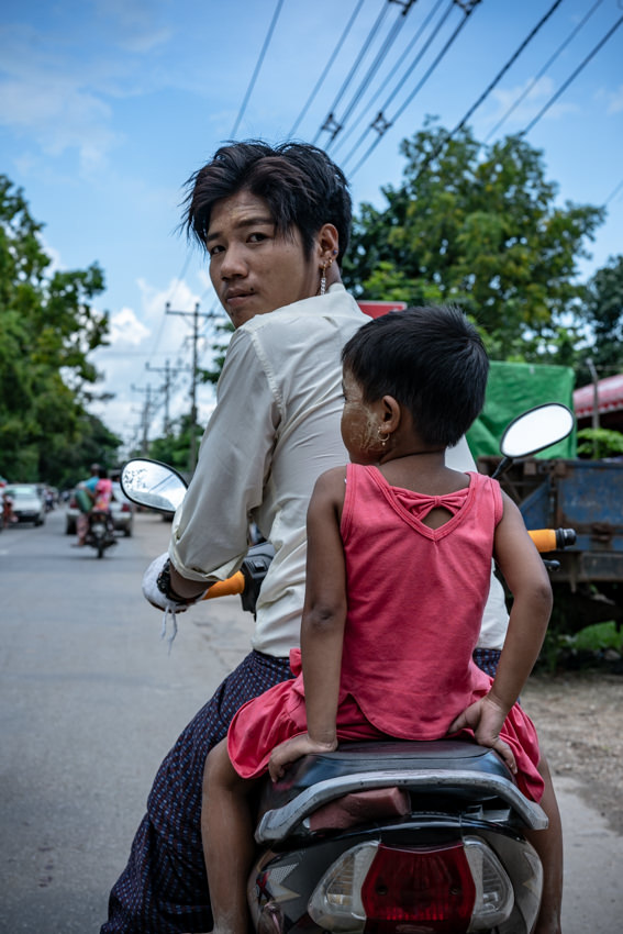 Young father riding motorbike with little daughter