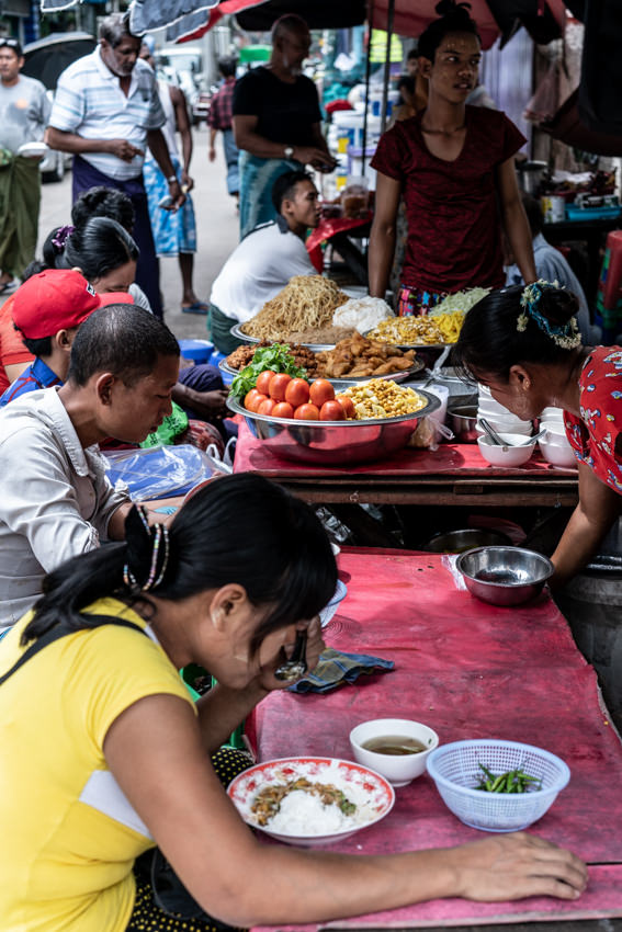 People having lunch at food stall