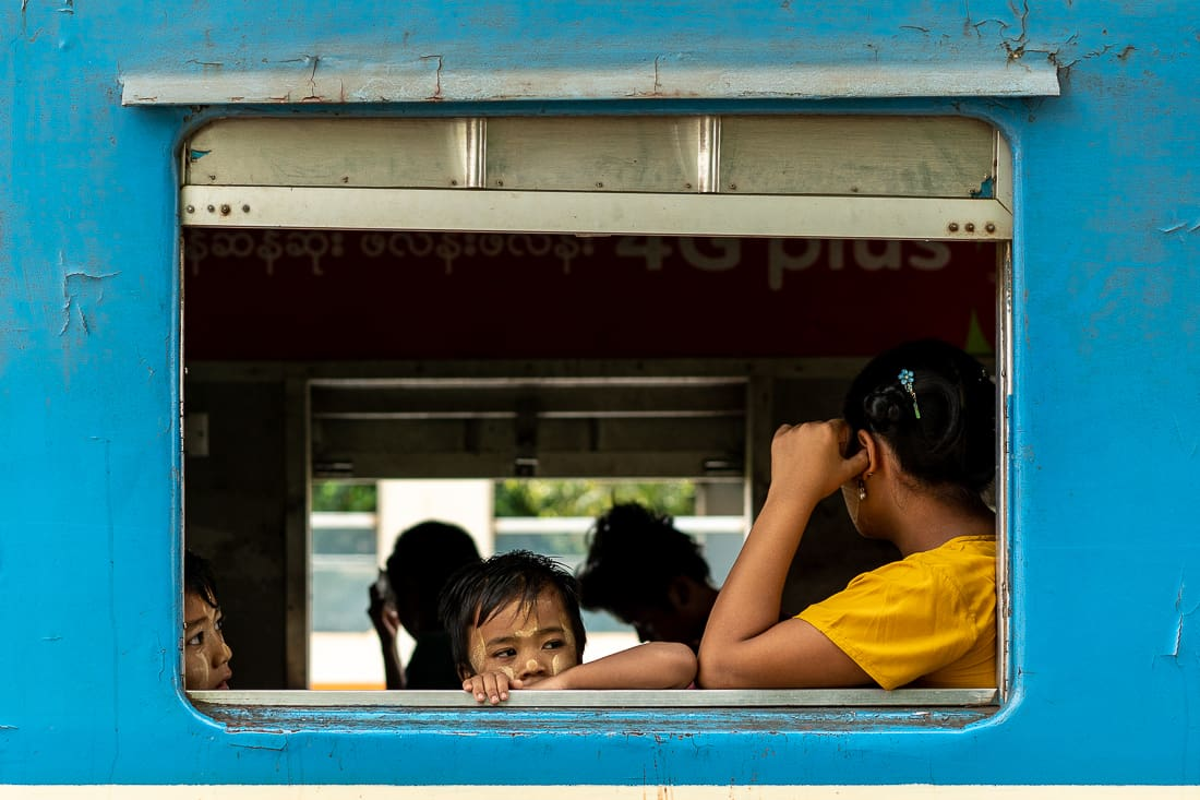 Parent and kids waiting for departure on train