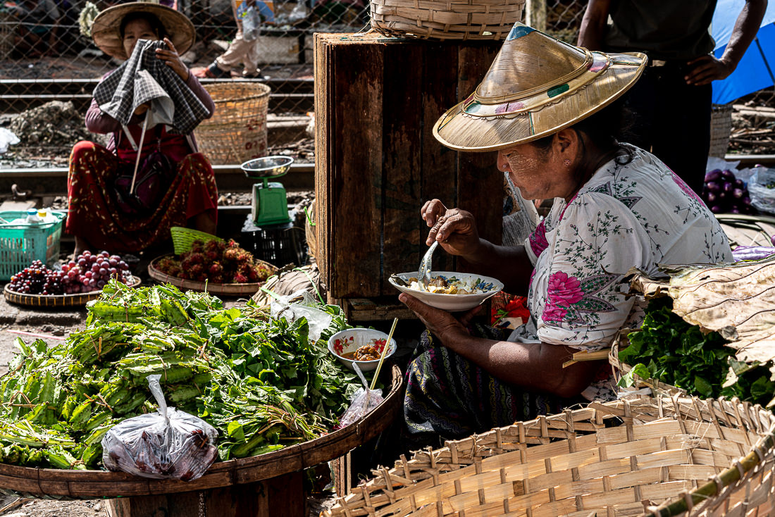 Female vendor having lunch while working