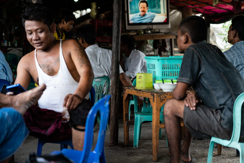 Men relaxing in eating place