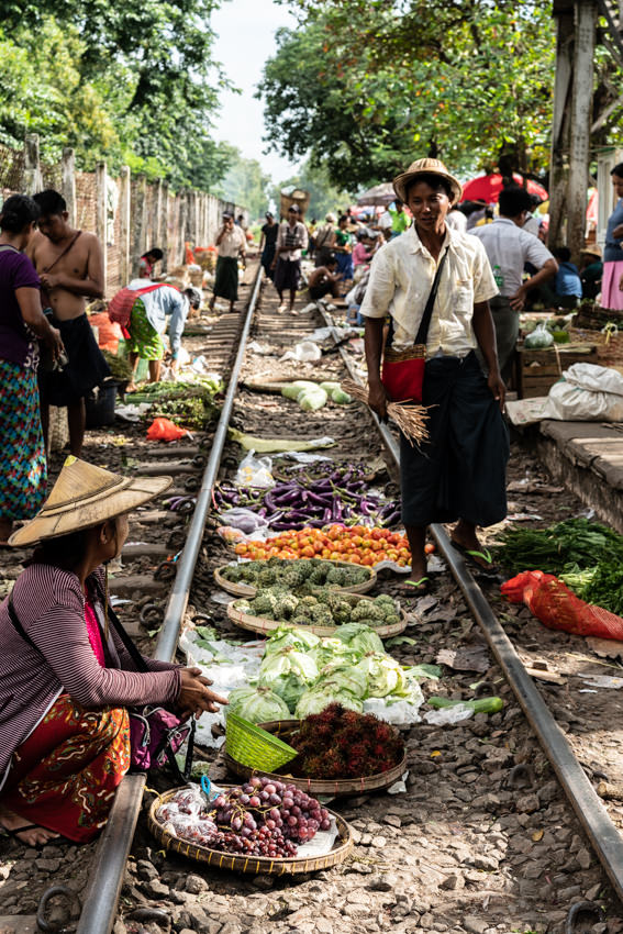 Woman doing business on railway track