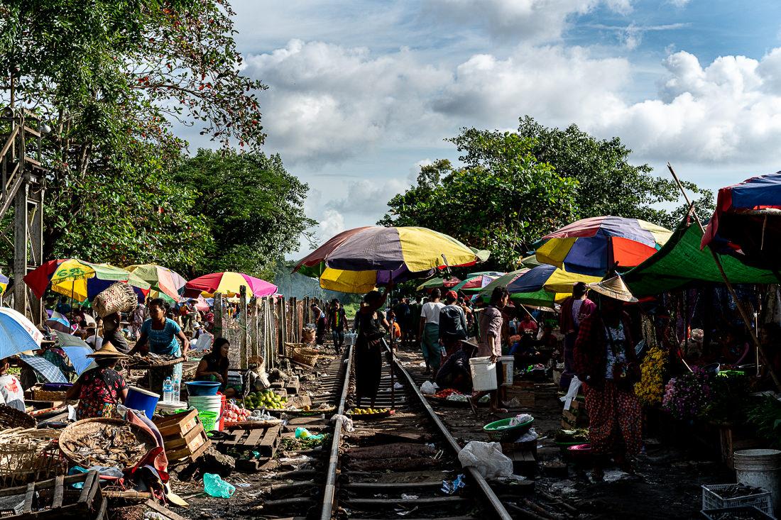 Colorful umbrella on railway track