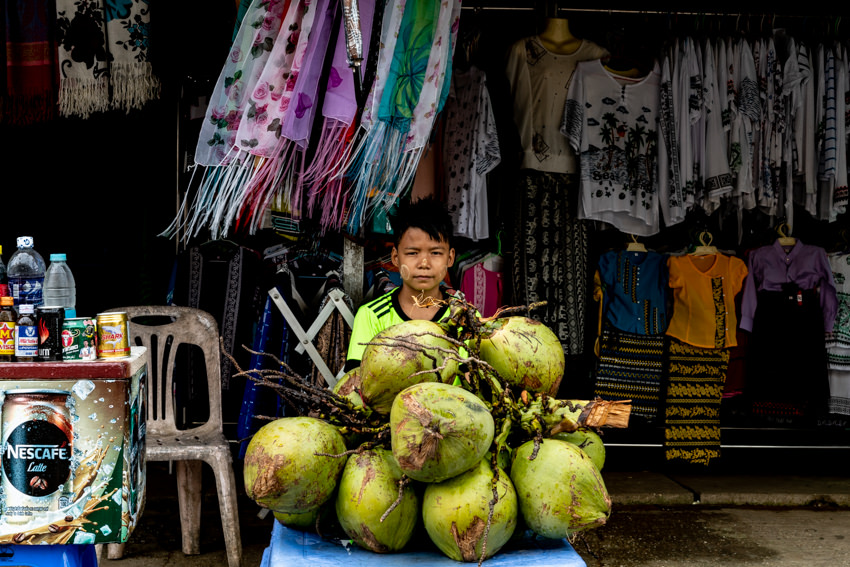 Boy selling coconuts