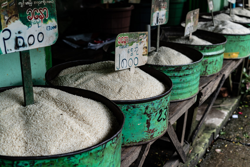 Various types of rice displayed in storefront