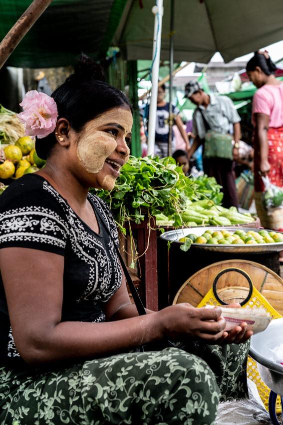 Floriated woman having bills in hands