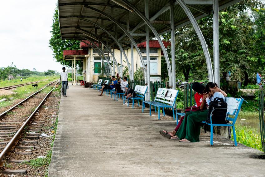 Boy giving comfort to girl on platform