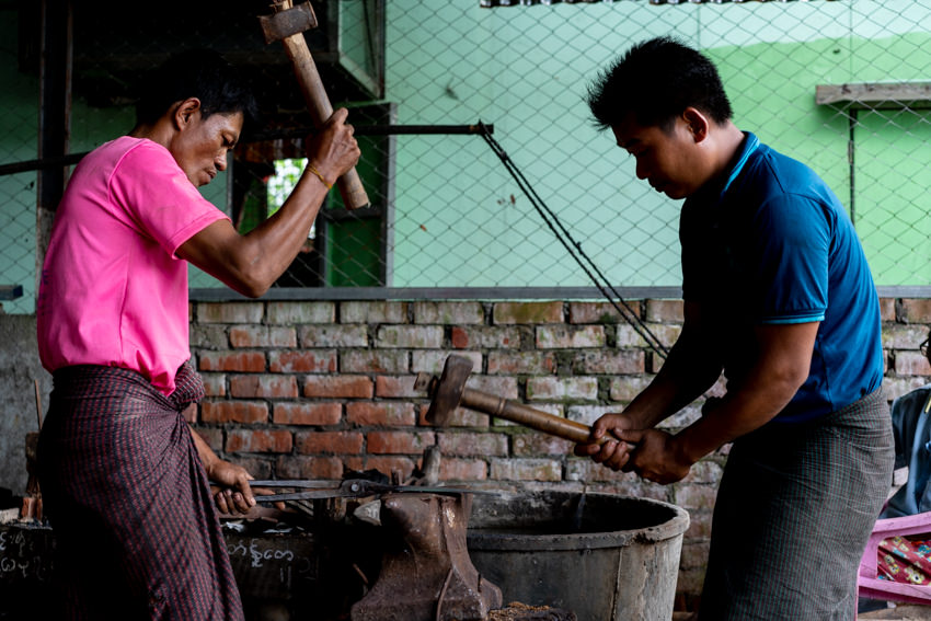 Blacksmiths beating with hammer