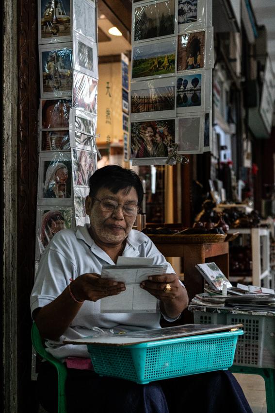 Man selling postcards